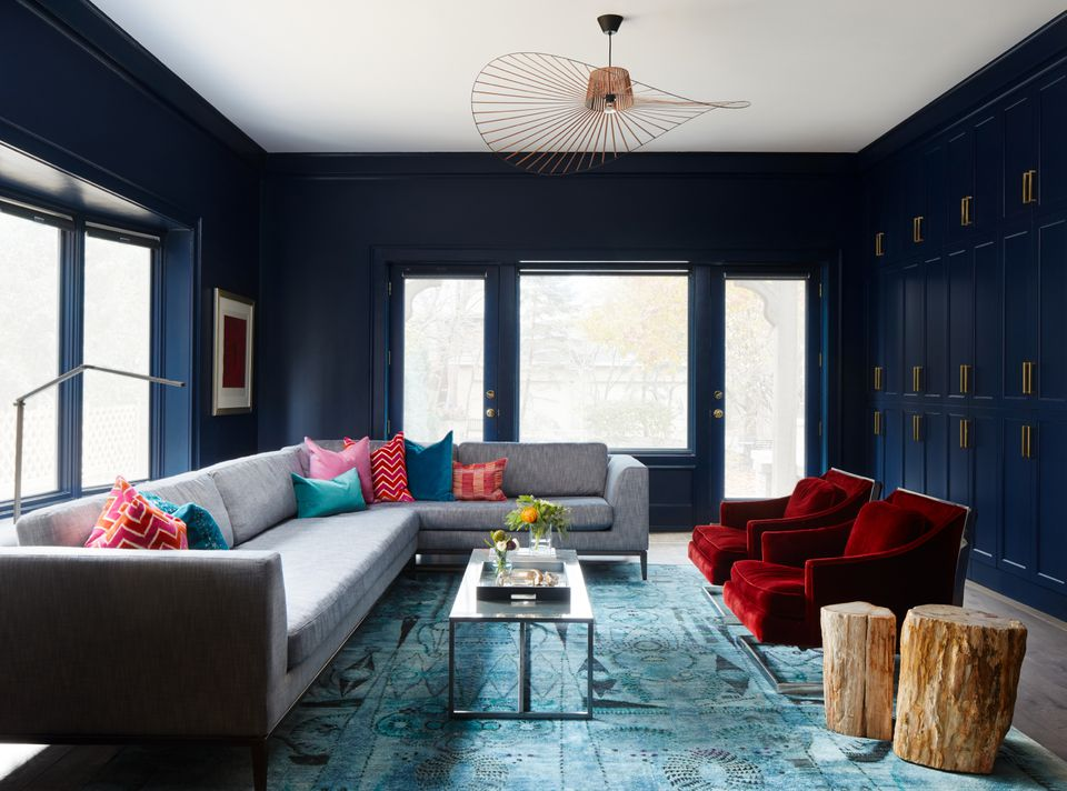 Navy room with colorful textiles.