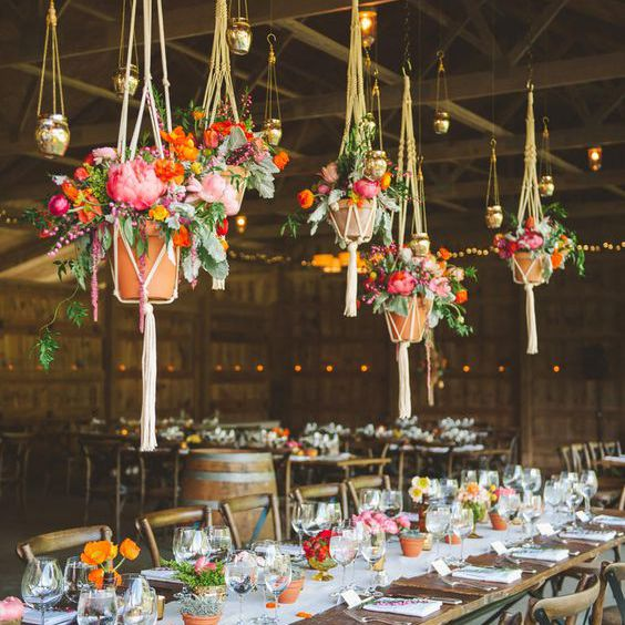 Hanging plant baskets in a barn