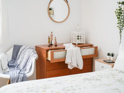 Messy bedroom with drawers