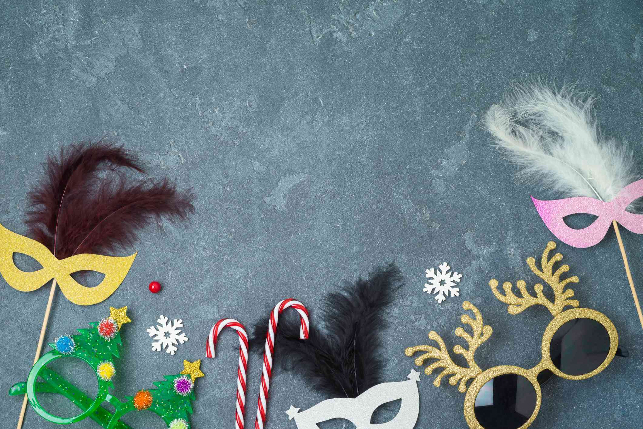 Carnival and New year party background with carnival masks, funny eyeglasses and photo booth props