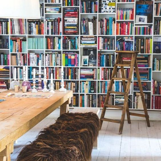 Home library with floor to ceiling book shelves