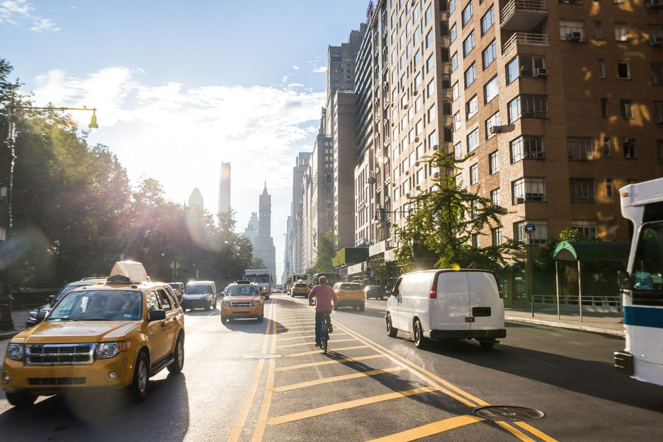 Traffic along edge of central park in early morning