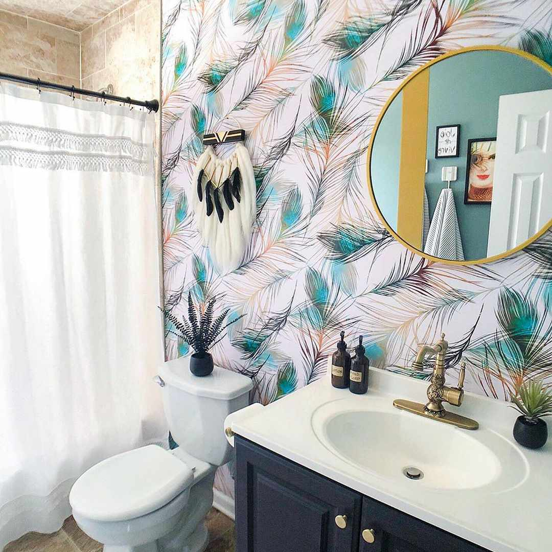 Bathroom with wallpaper and white shower curtain
