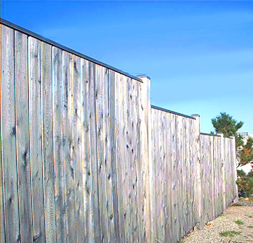 Picture of a privacy fence on a slope.