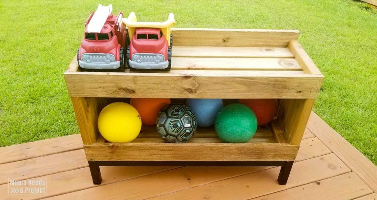 A wooden shelf with toys and balls on it