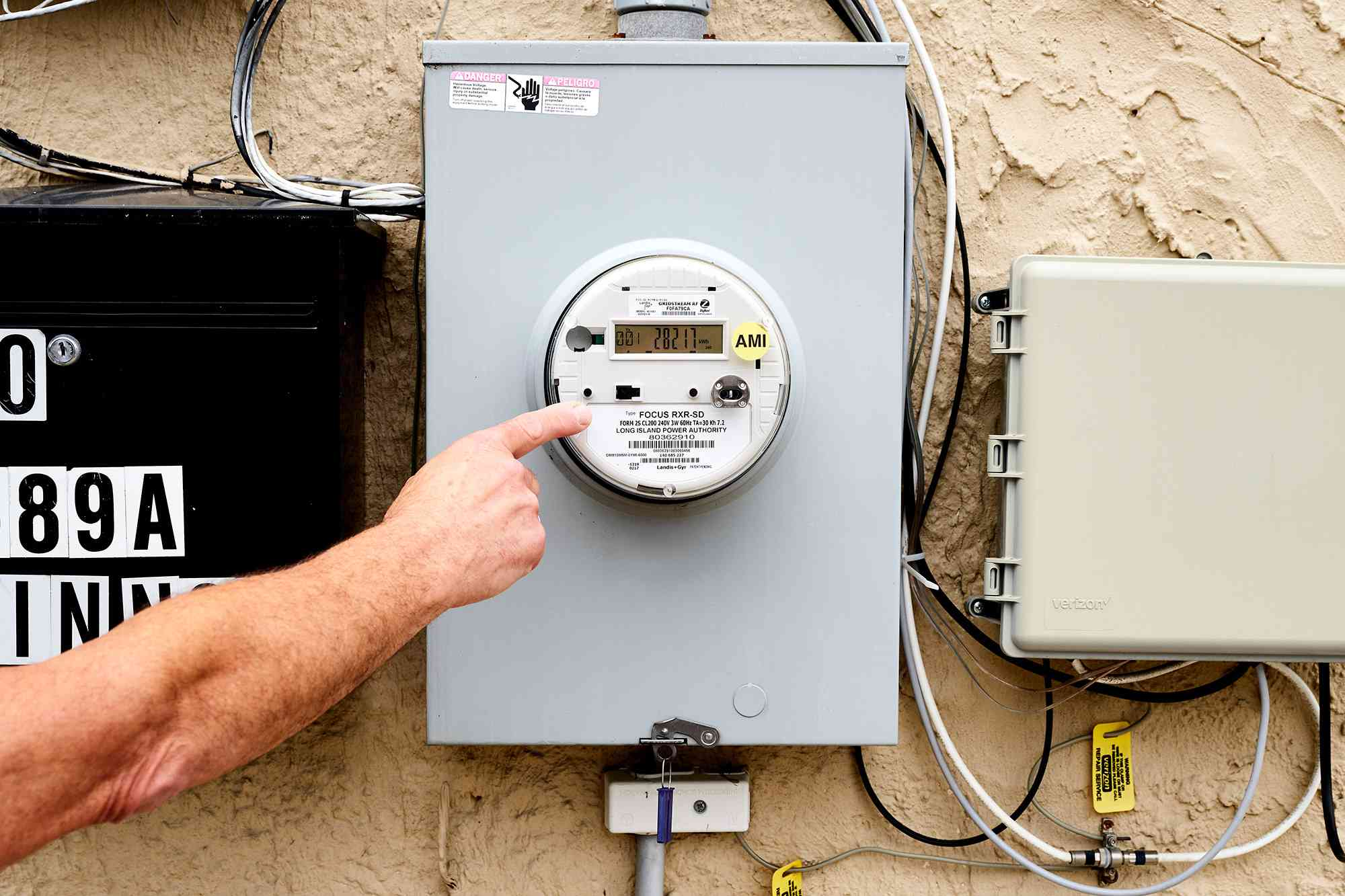 Electrical meter outside of home being inspected