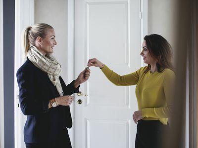 women passing keys