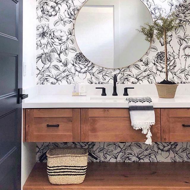 Bathroom with black and white wall paper