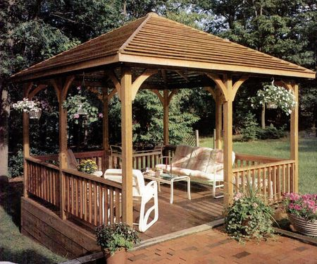 11 free wooden gazebo plans you can download today a diy wooden gazebo in a backyard solutioingenieria Choice Image