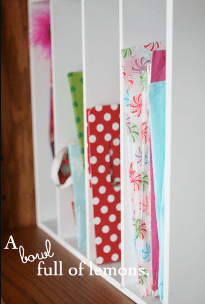 wrapping paper and gift bags stored vertically
