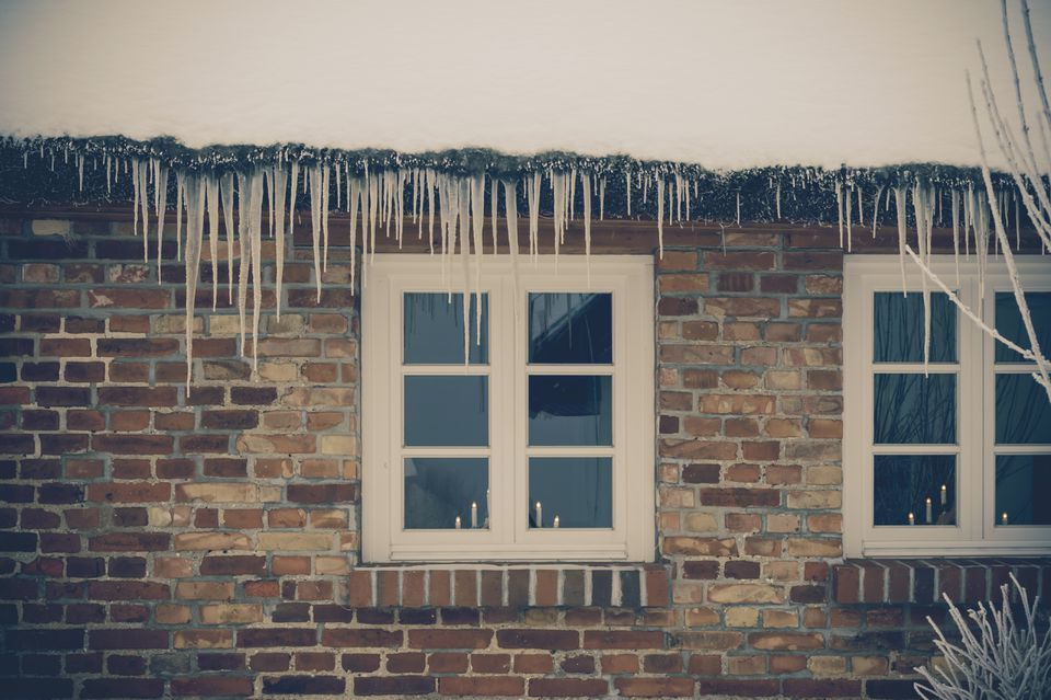 A frozen over house in the winter