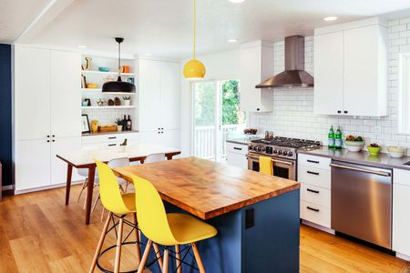 Pops Of Yellow In White And Blue Kitchen