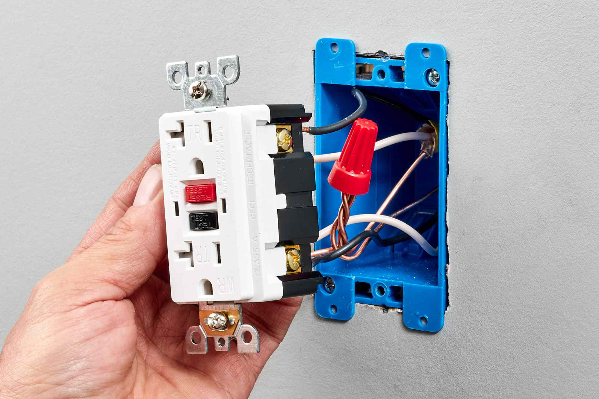 GFCI receptacle wired to front of electrical device