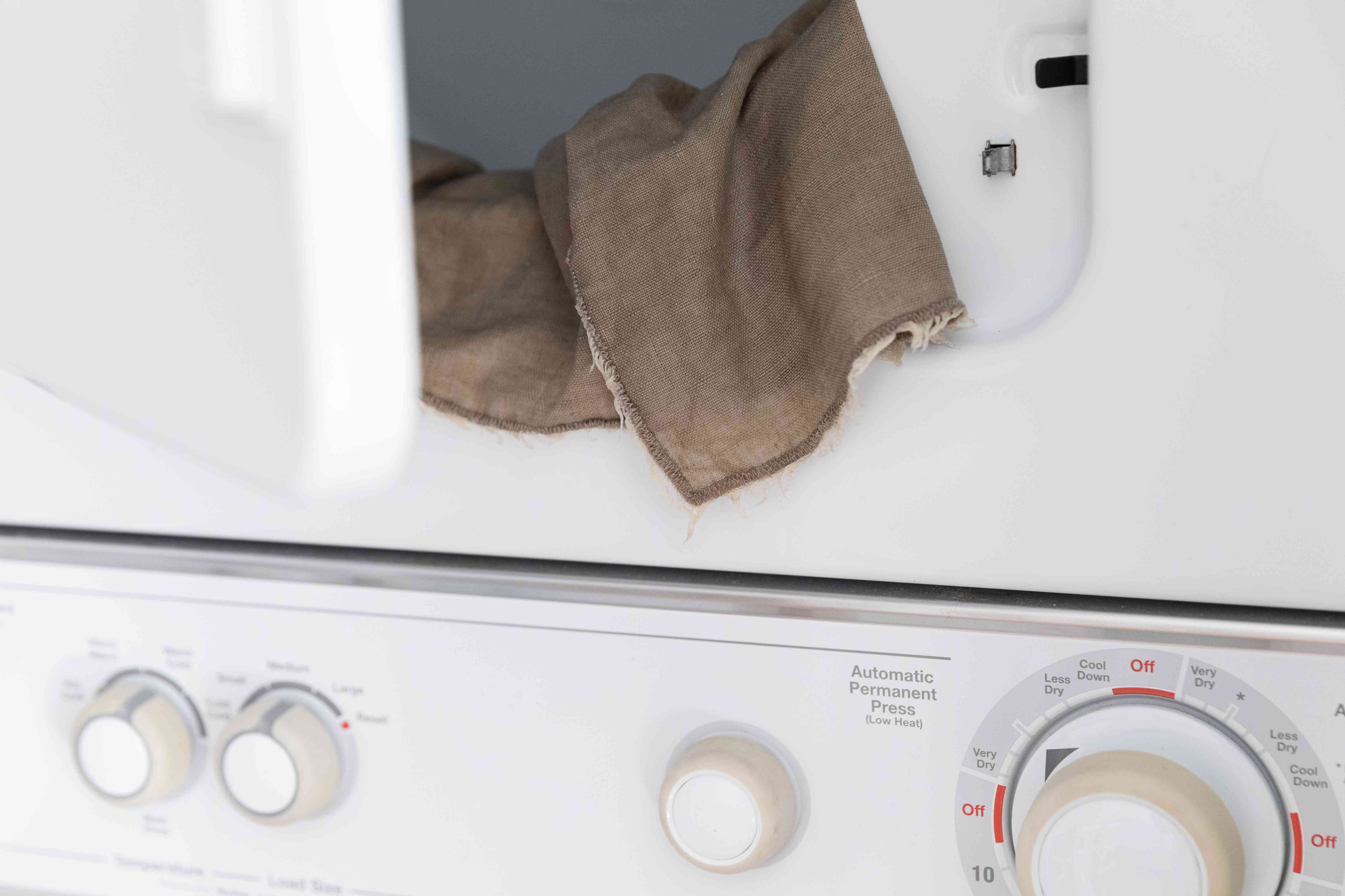 loading the linen into the dryer