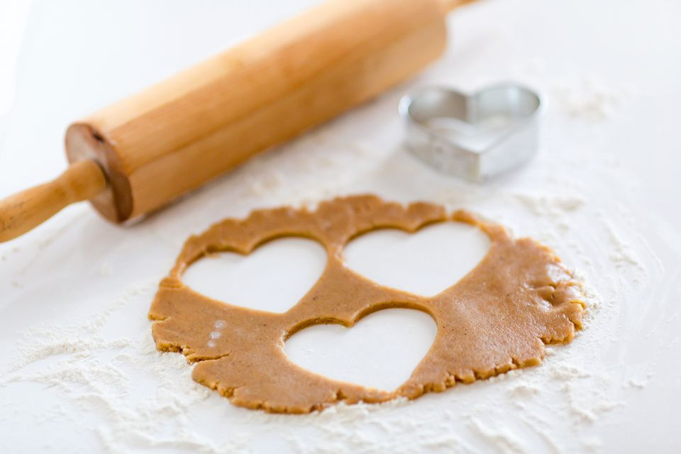 Close-Up Of Heart Shape Biscuit Dough On Table