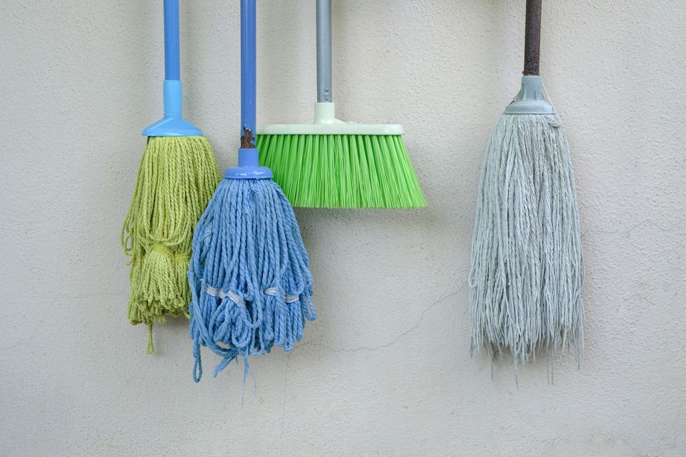 Hanging mops and brooms