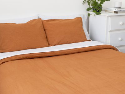 bed with a duvet and cover