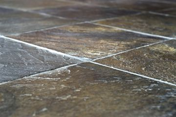 A closeup image of slate tiles and grout