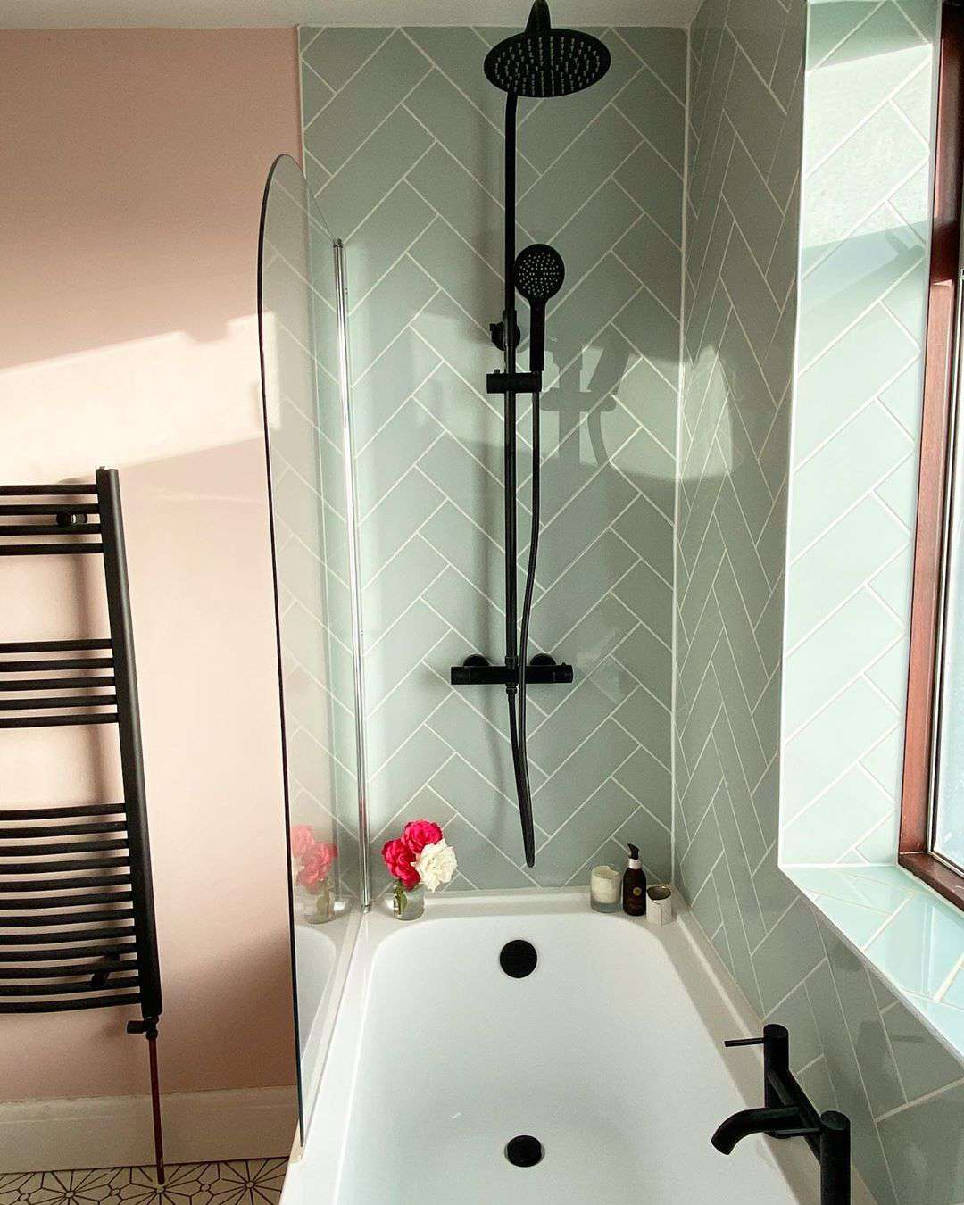 Bathroom with light blue tiles and pink walls