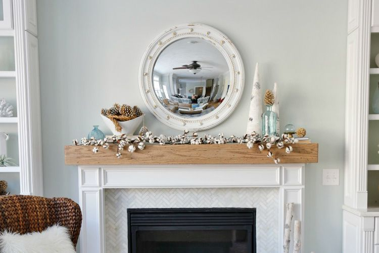 cotton stems on a mantel decorated for winter