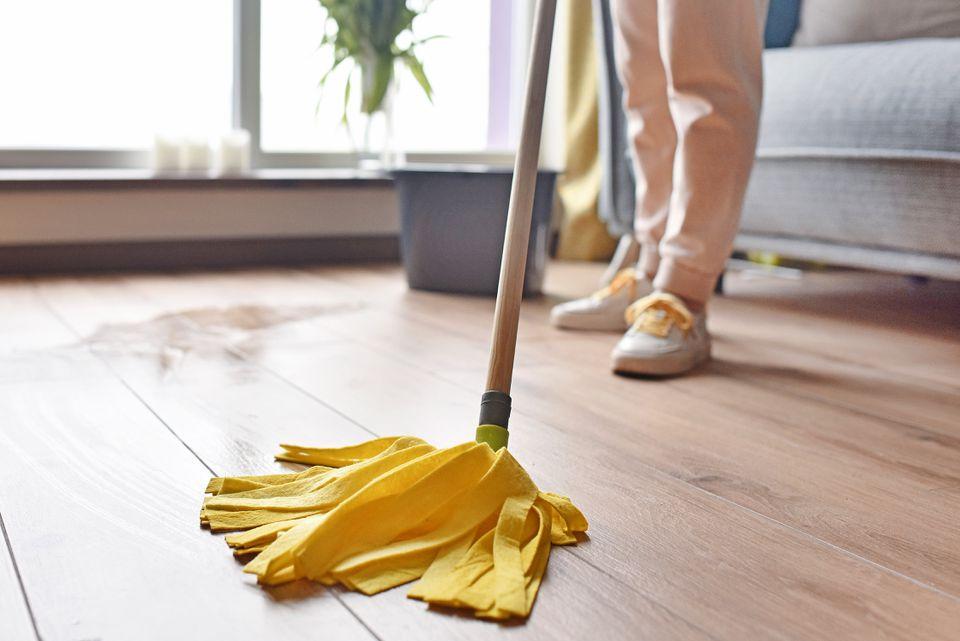 Wet mop cleaning wooden floor