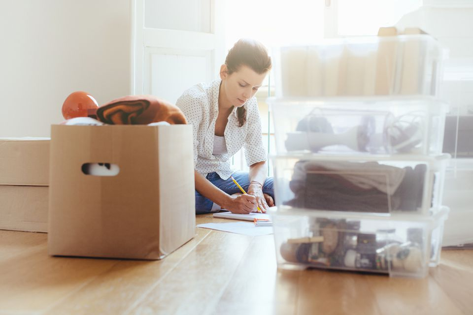 Woman packing clothes into boxes
