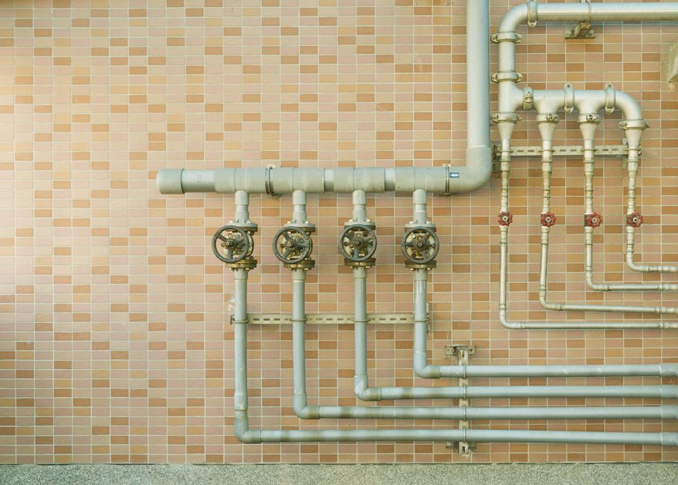 water pipes mounted on a brick wall.