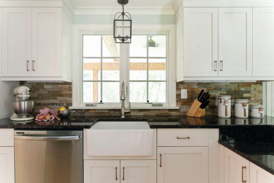 stacked stone backsplash in a farmhouse kitchen
