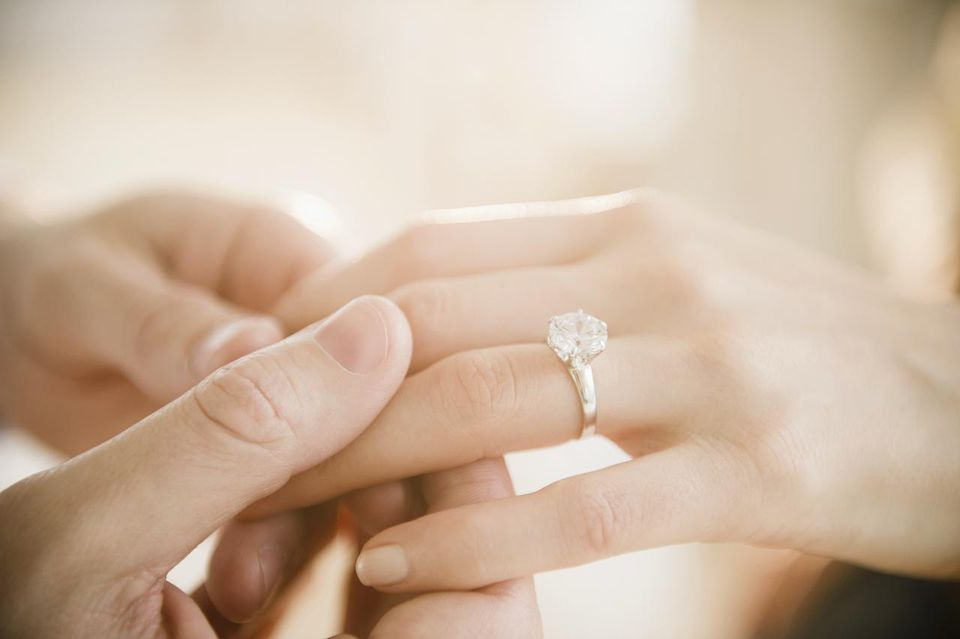 Woman's hand with a diamond engagement ring
