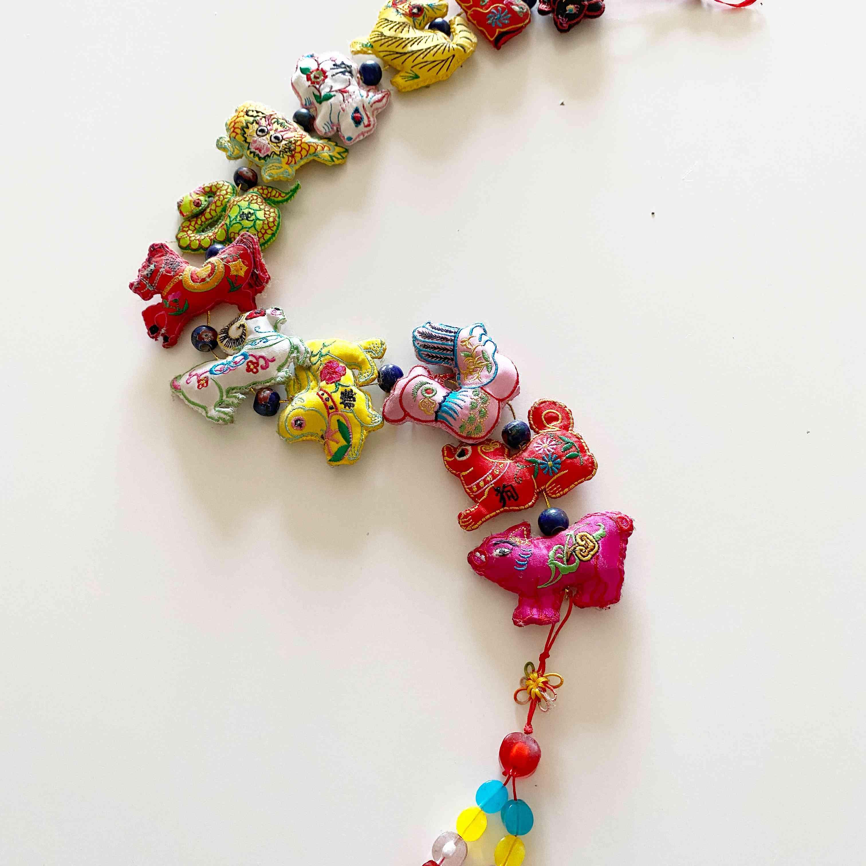 12 zodiac animals on a string