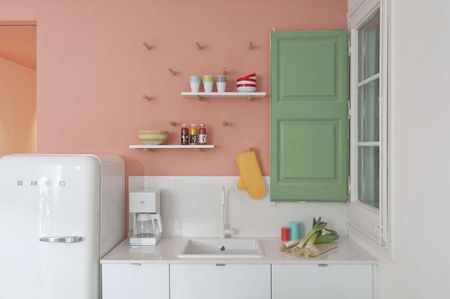 White Kitchen With Pink Feature Wall
