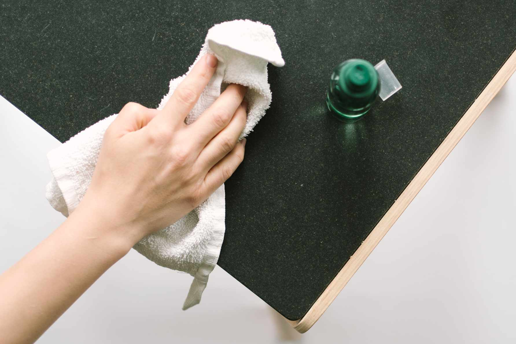 wiping down a countertop