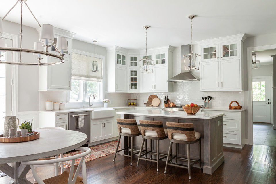 a white kitchen features multiple metals