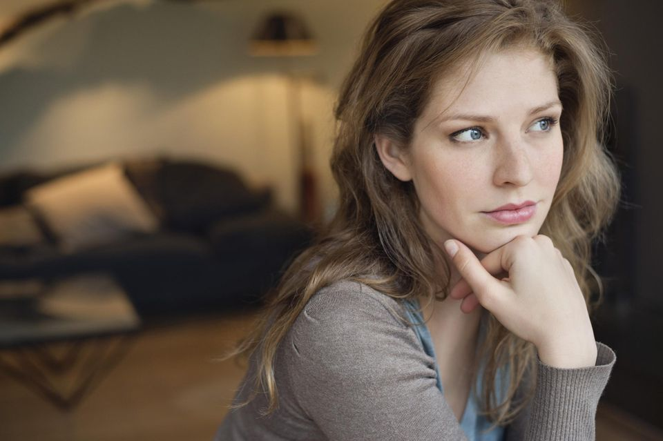 Close-up of a beautiful woman thinking
