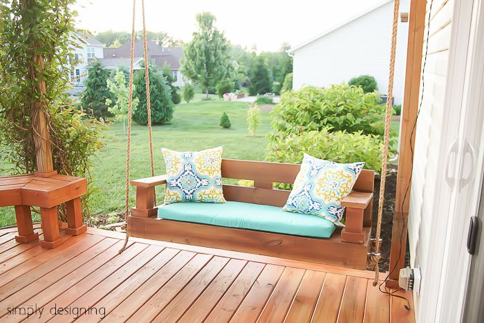 A Wooden Porch Swing On Deck