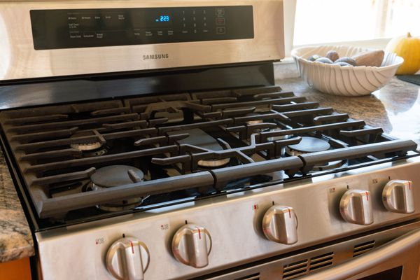 Gas stove top with black burners and stainless steel in kitchen