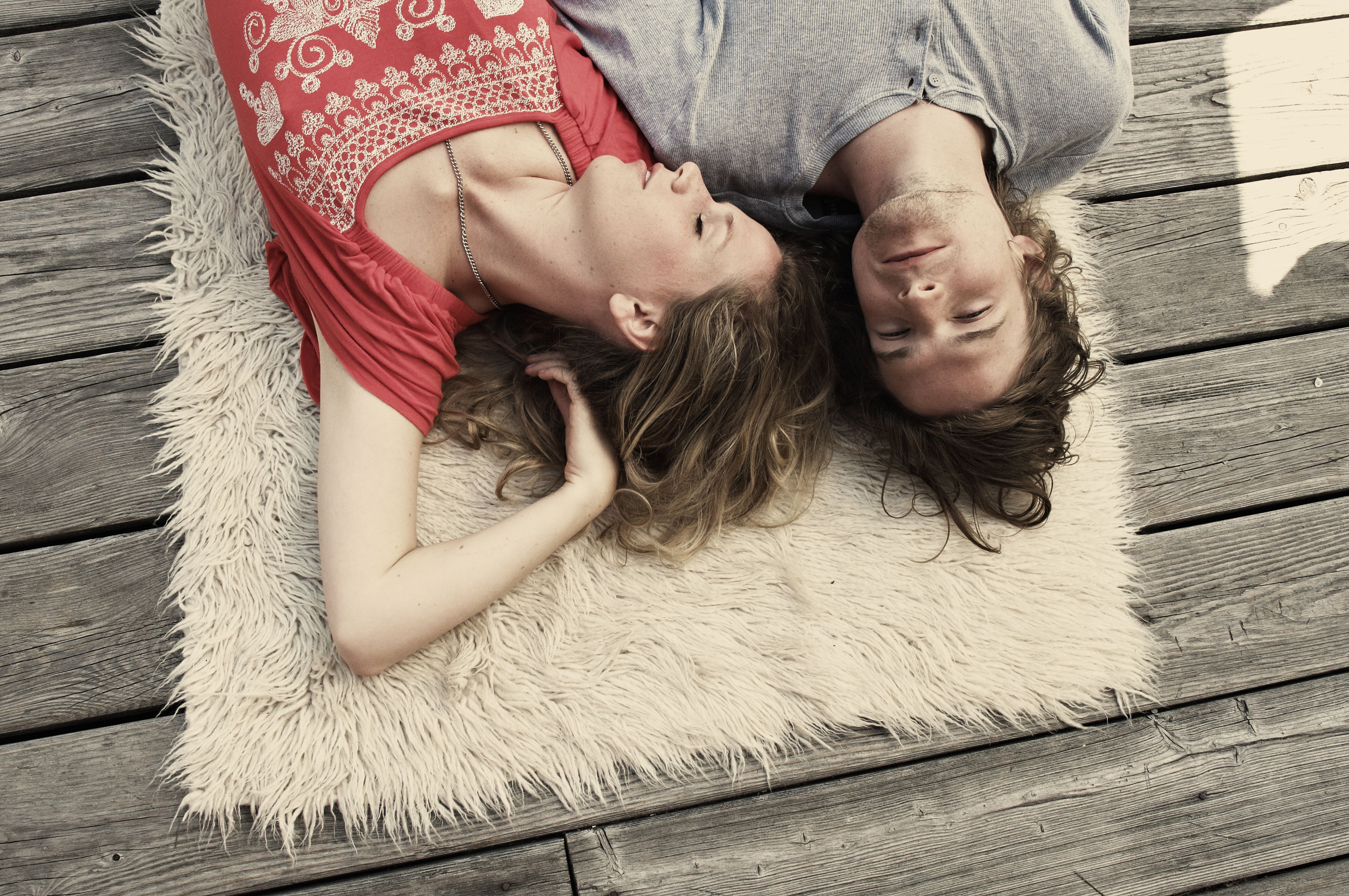 couple on rug on deck