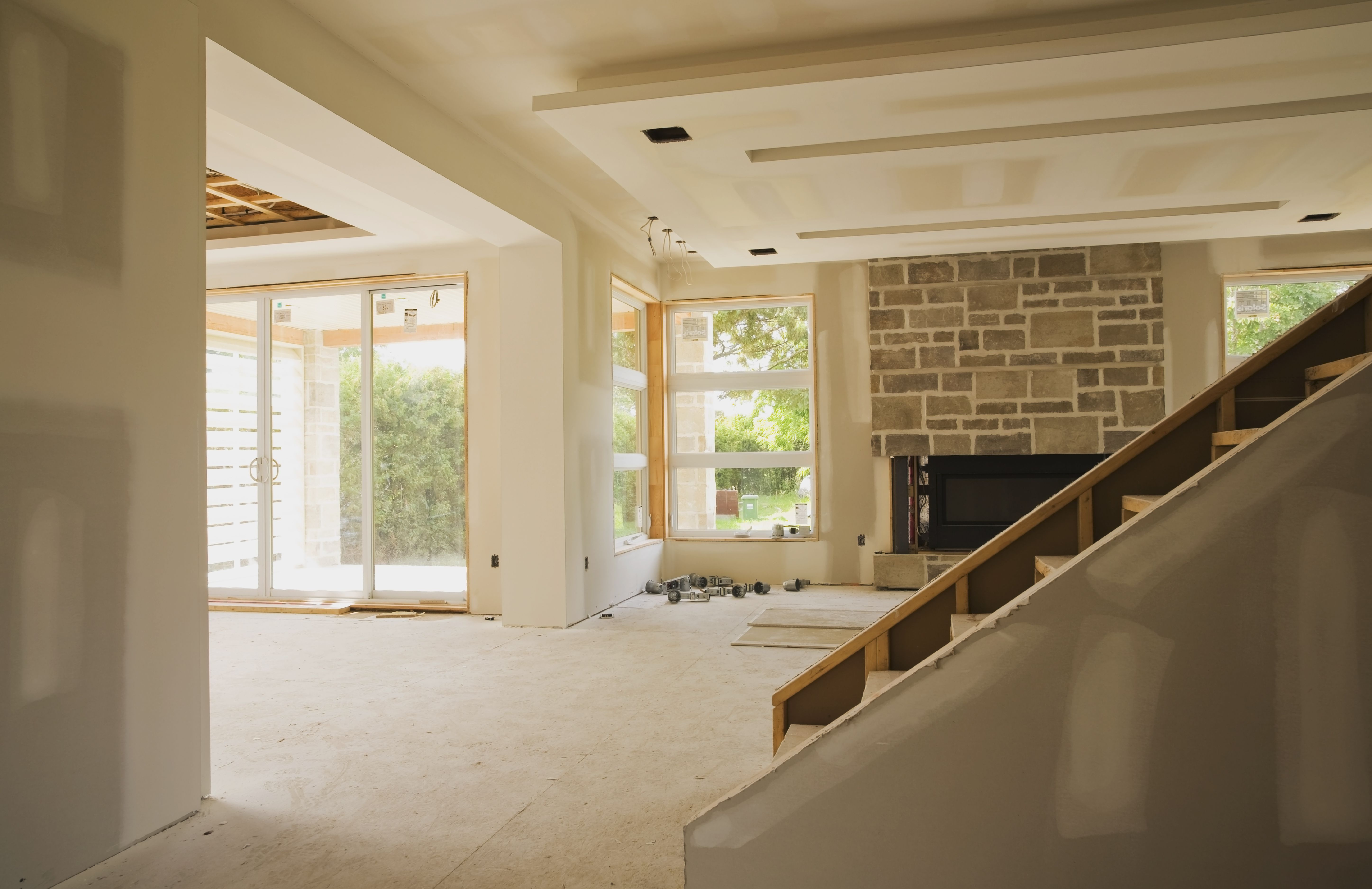 Unfinished Staircase And Living Room In An Upscale Residential Home