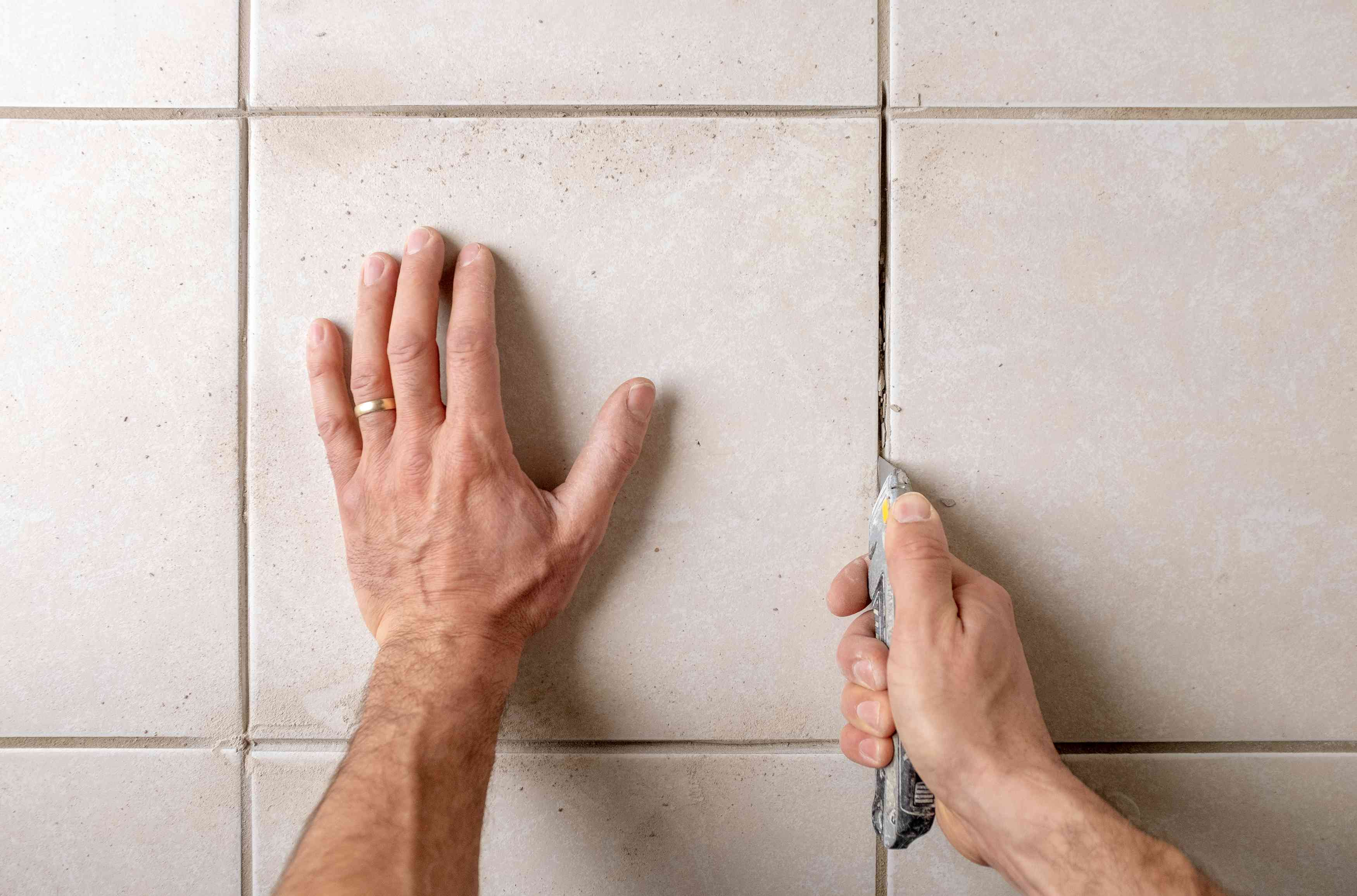 Use utility knife to remove remaining grout