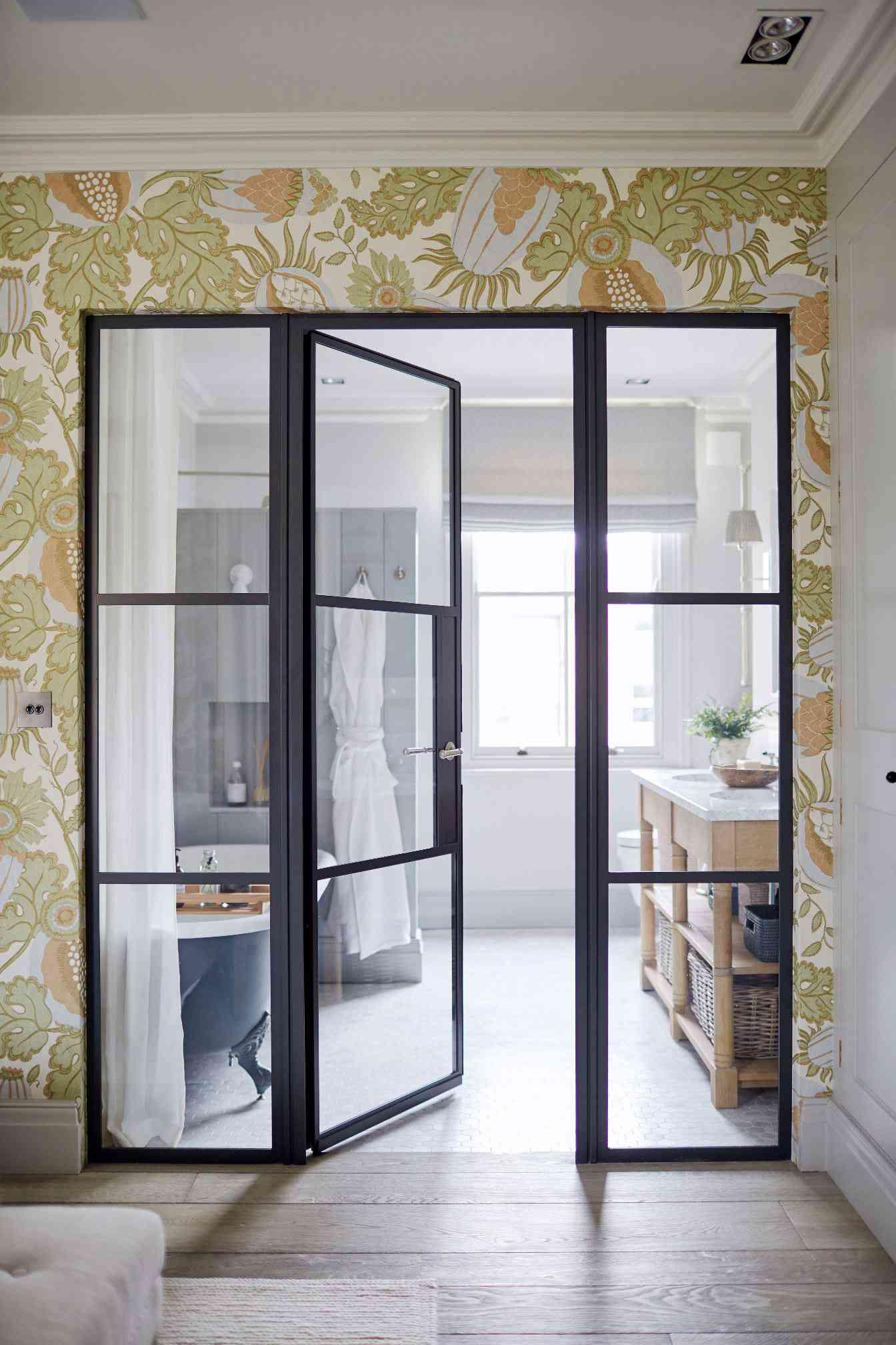 View into en suite bathroom with Crittal doors