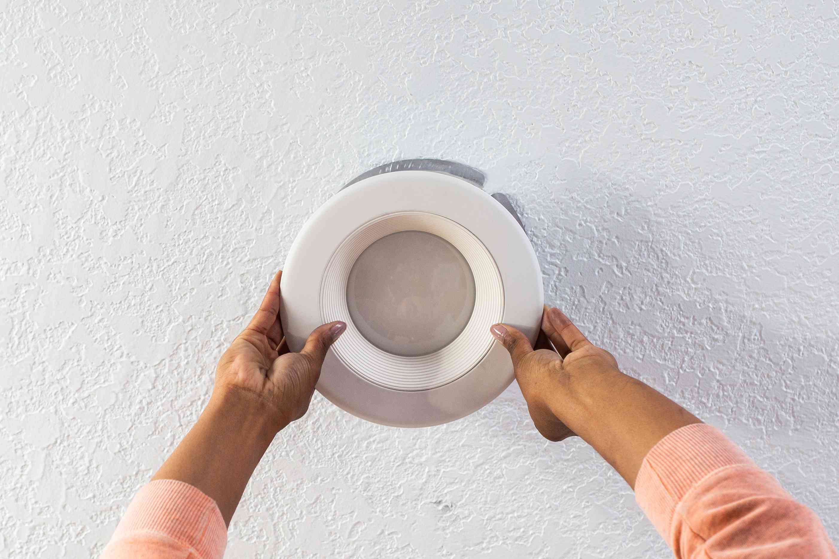Recessed fixture installed into ceiling hole