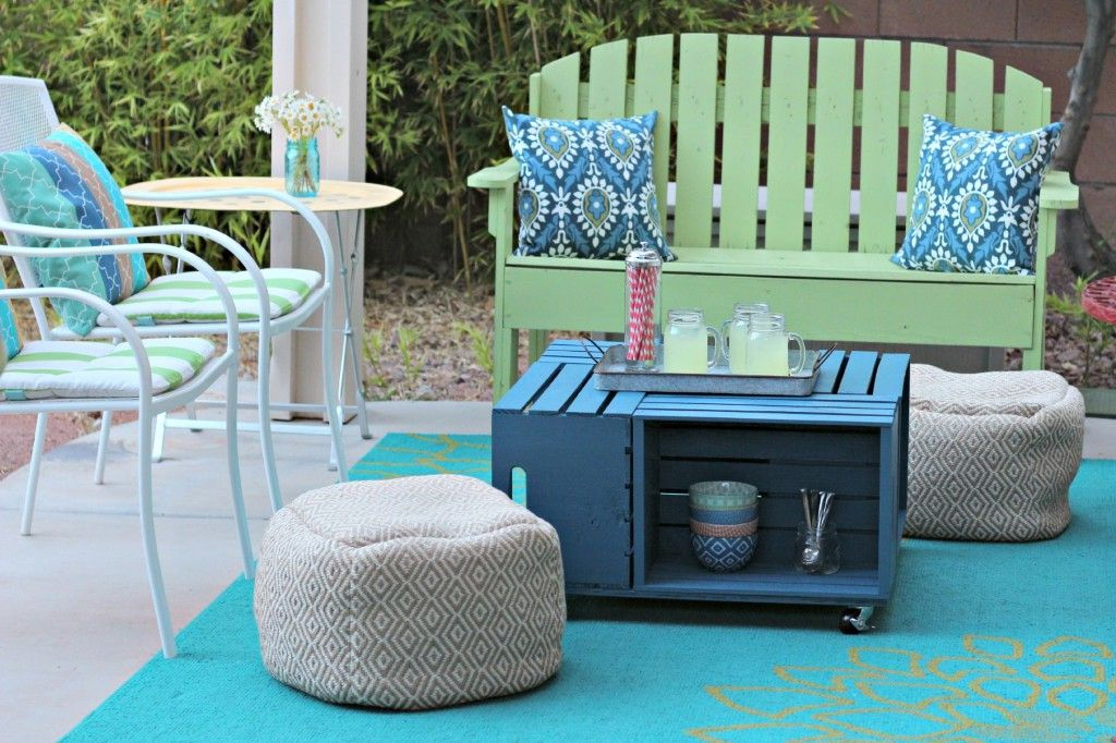 An outdoor coffee table, chairs, and bench