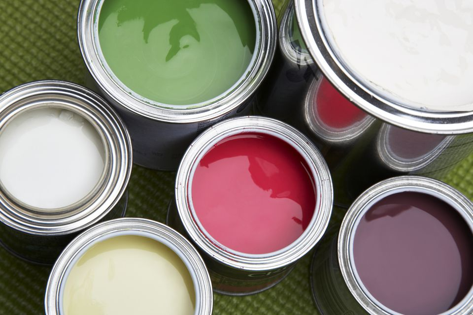 Open cans of paint shot from overhead