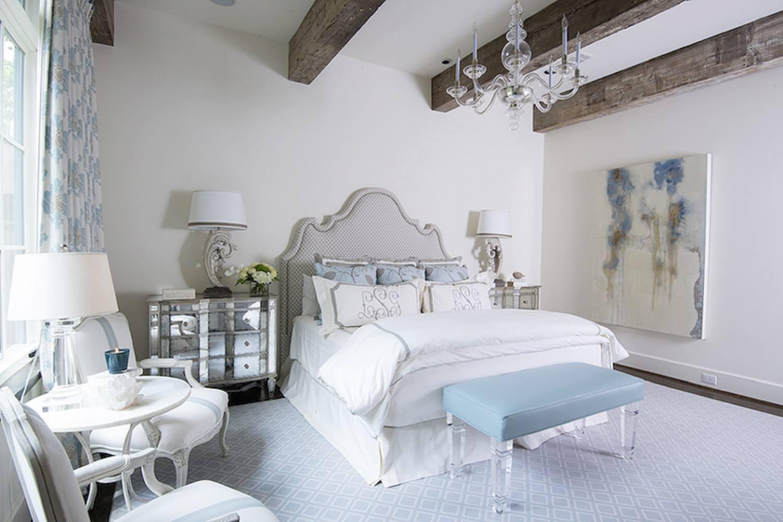 Glamorous bedroom with rustic beams