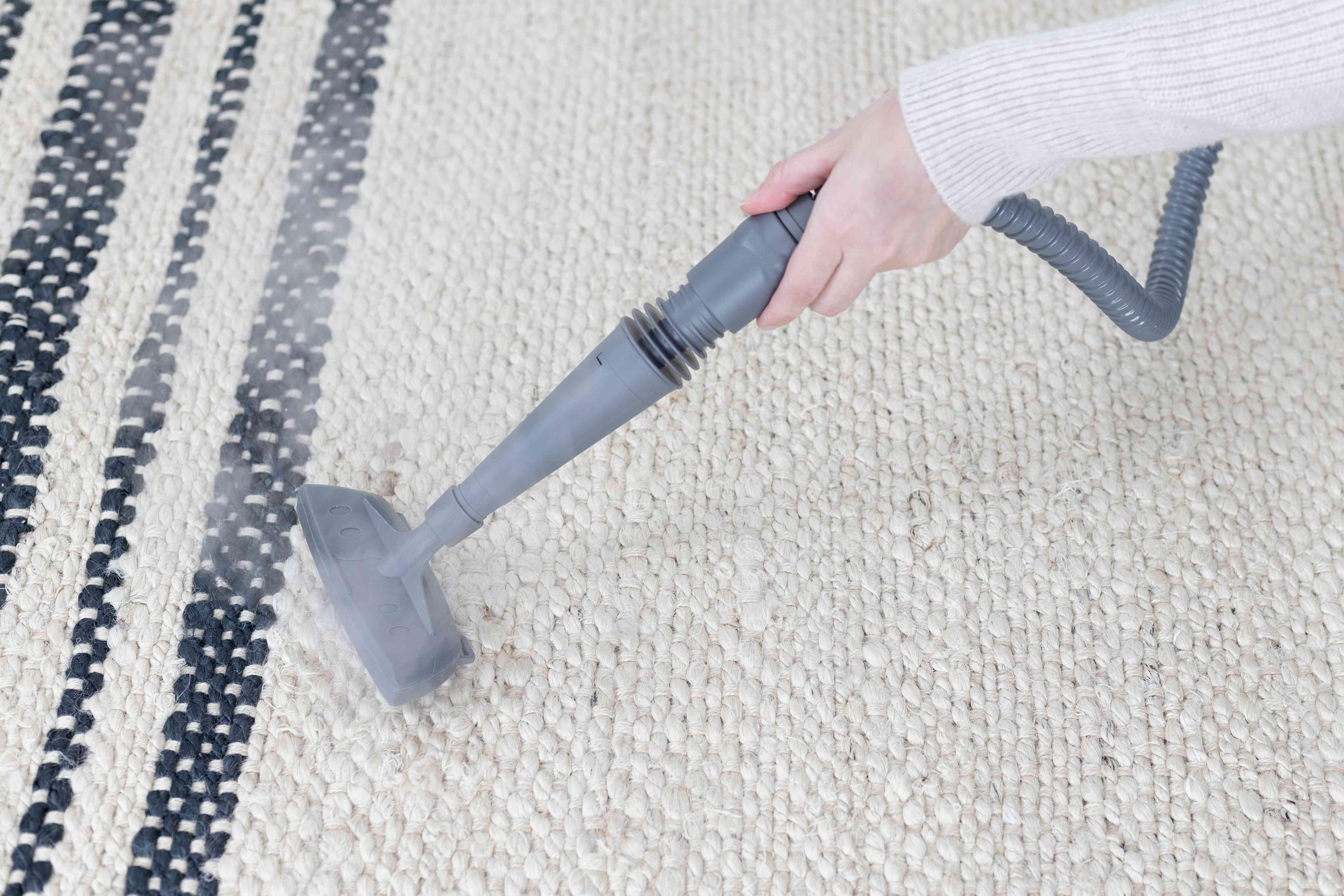 Woman steaming carpet