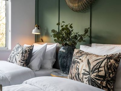 green bedroom with plants