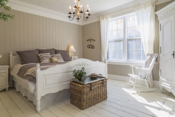 Bedroom with steamer trunk and armoire as dresser alternatives