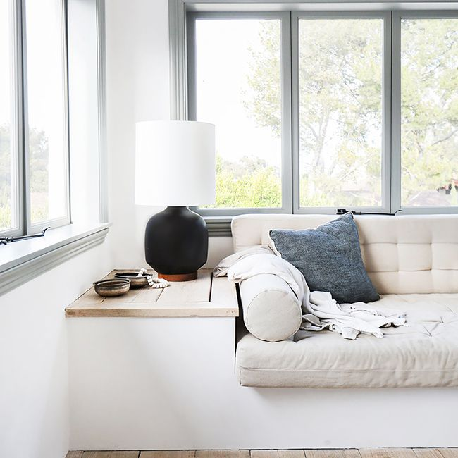 White sunroom with pull out couch