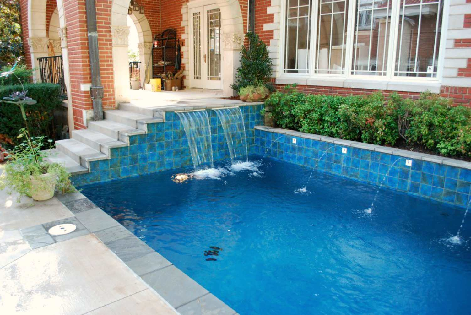 Pool with stairs and waterfall