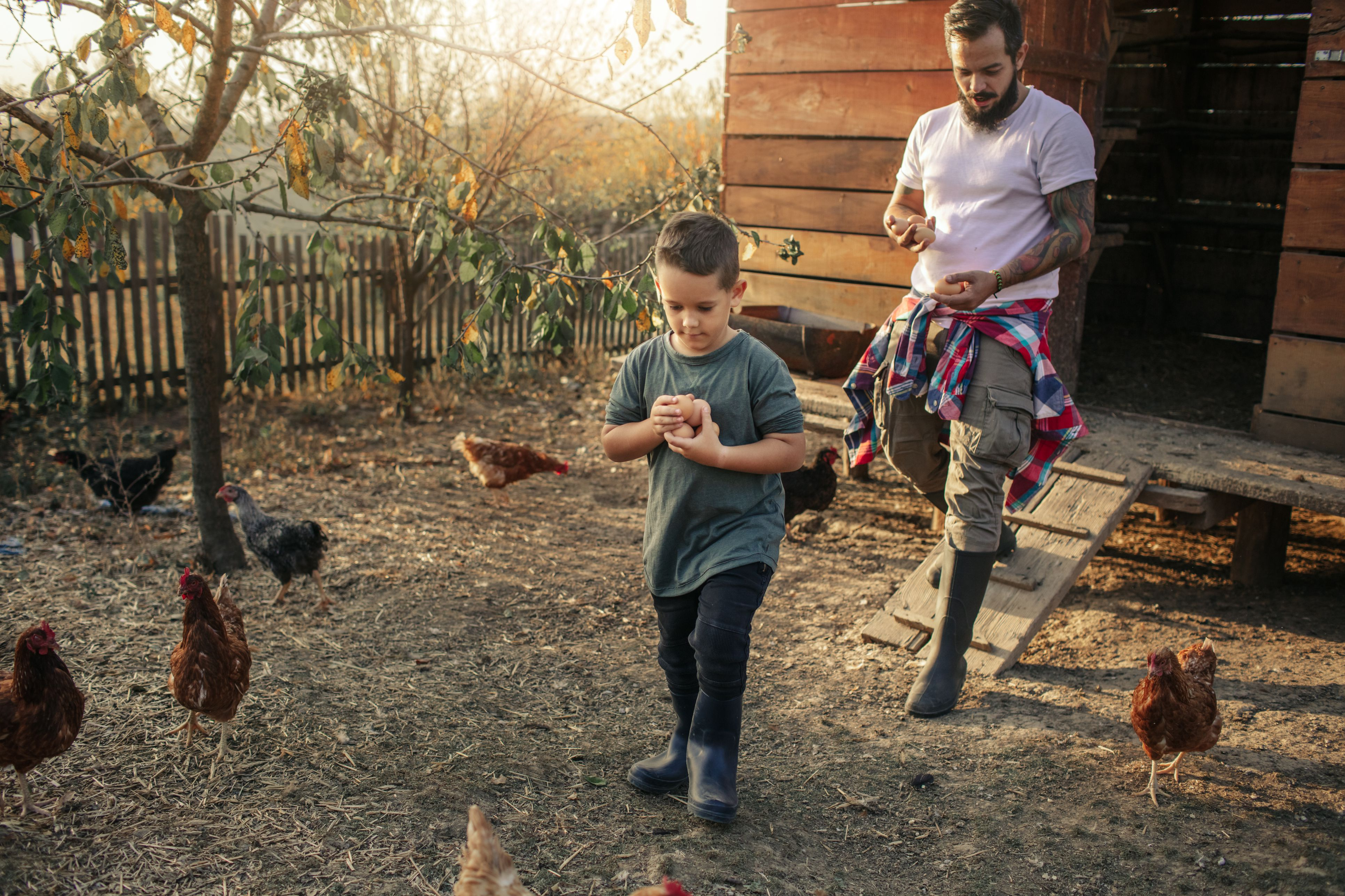 two people with chickens